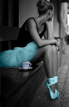 I love this pic for so many reasons 1:She has on pointe shoes 2:She's wearing a tutu 3 She's drinking TEA!!