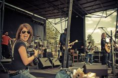 Photographer Teresa Lee. Hands down. Here, shooting Gary Sinise and The Lt. Dan Band in Colorado. She rocks it!