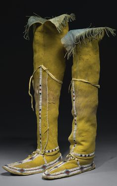 PAIR OF SOUTHERN CHEYENNE BEADED HIDE HIGH TOP MOCCASINS