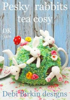 rabbits tea cosy - so cute, this is knitted but lovely crochet inspiration