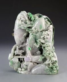 Chinese Carved Jadeite Mountain : Lot 33 / China, ROC Period, carved jadeite mountain, intricately carved with figure riding cow over bridge through a natural mountainous landscape, in light green and purple hues, decorated with natural mottled coloration in stone. Height 12 in. /est15-25k st 7.5k /Altair7:00 AM - Jun 28, 2014