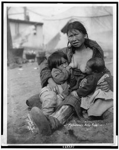 """Inuit woman tandem breastfeeding TITLE: """"Mickaninies Kow-Kow"""" CREATED/PUBLISHED: circa 1904.    REPOSITORY: Library of Congress"""