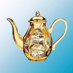 24K Gold Plated Coffee Pot Standing Free Standing - Clear - Swarovski Crystal by Crystal Delight by Mascot. $9.88. Swarovski Crystal. Superb metal craftsmanship. Genuine Austrian crystal. 24K Gold Plated. Perfect for gifting. This 24K Gold Plated Coffee Pot Standing ornament features Austrian Swarovski Crystal. This is an original Crystal Delight ornament! Wow!!! This is the finishing touch to just about any room in your home! Swarovski Crystals sparkle beautifully against th...