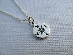 Sterling Silver Compass Necklace - Hand Stamped Compass Charm Necklace - Sterling Silver Chain. $30.00, via Etsy.