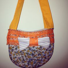 Handmade purse with blue floral and orange lace and accents www.etsy.com/shop/cherrydew