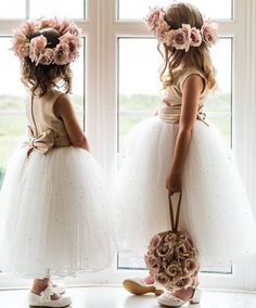 Precious flower girls in tulle dresses with flower crowns