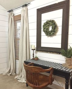 Just a little progress. This is my work station in the master bedroom. What you don't see is that I have an entire wall to go with shiplap  Curtains: @homedepot  drop cloths Chair, table, frame: thrifted  Table runner: hand made Faux plants and wreath: @tjmaxx