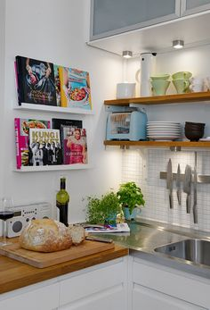kitchen with cookbook display and open shelving
