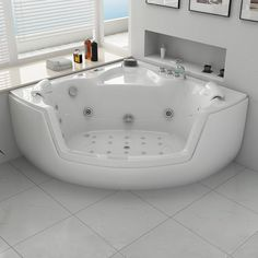 Baignoire balnéo d'angle avec hublot pour cocooner dans votre salle de bain