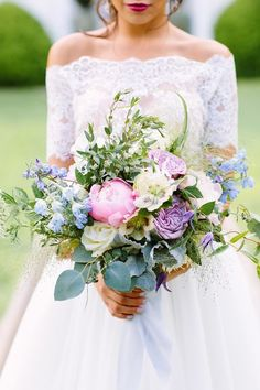 Spring wedding bouquet idea - overflowing wedding bouquet with pink, purple and blue flowers {Blue Sparrow Events}