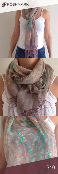 """Spring floral scarf Multi colored floral design on gray/taupe background. Fun fringe on each end of scarf. Can be worn multiple ways. Length from seam to seam. Length 70"""", width 19.5"""". 100% polyester. Smoke free home Maurices Accessories Scarves & Wraps"""