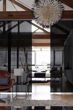 Panel Tracks and Sliding Panels are a stylish alternative to vertical blinds. Sliding panels are the best window shades for modern homes. Panel tracks work great on large windows, sliding glass doors, or as a room divider. Decor, Room, Modern Room, Home, Modern Room Divider, Interior Spaces, House Interior, Sliding Window Treatments, Space Dividers