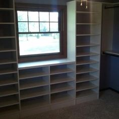 This bedroom with two windows, a door and a small reach-in closet was turned into a master closet.