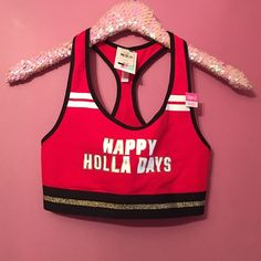 "Victoria's Secret  PINK Holiday Sports Bra NWT Victoria's Secret ""Happy Holla Days"" red sports bra. Size S. Fits sizes AA-C. New with tags. PINK Victoria's Secret Tops"