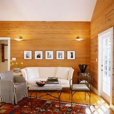 Warm, modern family room with horizontal wood covered walls.