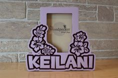 www.woodpeckerwoodshop.etsy.com Personalize this hawaiian tropical themed hibiscus picture frame for the favorite kid in your life!  Search on Etsy for WoodpeckerWoodShop for 100+ personalized children's frames - choose your name, colors and theme!