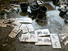 Sketchbooks and painting materials on John Virtue's studio floor.