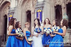 but then again...I LOVE the white with a pop of blue/purple bouquets...and the bridal bouquet = perfection!
