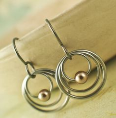 Our Three Hoops Petite Niobium earrings are perfect for dress up or casual wear, for a gift or for you. They are wonderful in their simplicity and versatility! Theyre quick to make yet have long lasting style. Buy the kit and make them yourself or we will make them for you. Select Ready Made from the drop down menu.  These handmade earrings feature your choice of Swarovski Pearls or Metal Beads (Gold or Silver Plate). They measure 1 inch, (26mm) and feature my handmade hypoallergenic niobium…