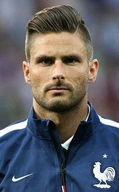 Good: Olivier Giroud from The World Cup's Hairstyles: Best, Worst & Inexplicable  Oh la la, Olivier! As if this French soccer stud weren't gorgeous enough already, he's got a killer slicked-back 'do.