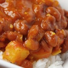 """Puerto Rican Style Beans"". says the original site, and indeed the cubanelles and the use of pink beans give this vegan recipe at least a LITTLE PR flavor... Me, I'd use 1 to 2 whole onions, more garlic, more oil, a whole cubanelle, and cook the pink beans from scratch instead of use canned. But, as written, it is quick and lo-cal. And sure looks pretty! "" https://www.facebook.com/CrescentDragonwagonFearlessly"