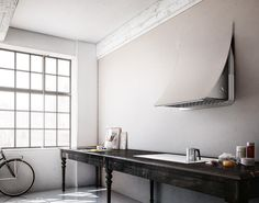 """Nuage is the first hood perfectly integrated into the architecture of the kitchen, in continuity with the wall.It is a """"discrete"""" household appliance due to its sinuous shapes, highly customizable, offering the option to cover the external panel with plasterboard, tiles or paint, allowing therefore a perfect symbiosis with the kitchen and the living room"""