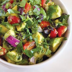 Avocado Dip - This dip—with avocado, black beans, tomatoes, and red onion—will be gone in no time at your next get-together