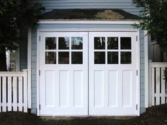 White carriage style garage doors with windows.