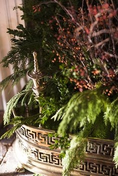 Fireplace filled with greens and berries for the holidays… || Lisa Hilderbrand - Hilderbrand Interiors www.hilderbrandinteriors.com
