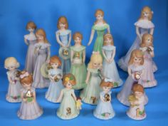 Enesco Growing Up Birthday Girls-- my Grandma started giving me these for my birthday starting with age 8, but then stopped around 13 I think.  I don't know if she forgot or couldn't find them any longer, or thought I grew out of it, but I loved unwrapping them every year & seeing what the next one looked like.  Some of mine have blonde hair, & some have brown, haha!  I appreciated those gifts.