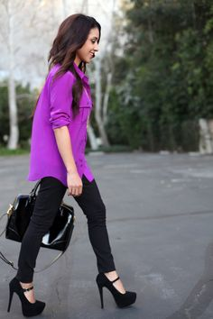 Purple shirt, black pants.