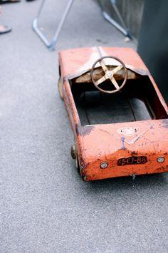 old & rusty tin car