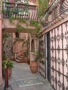 GRILLE ON WALL  Sicily, Italy: Courtyard, Villa Ducale