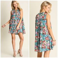 """Jade Floral Trapeze Swing Dress Classic and elegant Jade color dress with floral designs. Wear it as a dress or tunic. Features a front key hole closure. Made of soft cotton/poly blend.  Striped  The dress is oversized. If you want a smaller cut, size down.   Measurements  Small ~ fits a medium  Bust 46"""" / front length 30.5""""/ back length 33""""  Medium ~ fits a large  Bust 48"""" / front length 31.5""""/ back length 34""""  Large ~ Fits XL Bust 50"""" / front length 32.5""""/ back length 35"""" Bchic Dresses"""