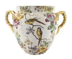 A German Ceramic Jardiniere, Height 14 inches.