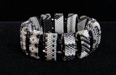 With lots of texture and loads of sparkle, this easy-on, easy-off stretch bracelet is sure to become a favorite. I selected complimenting colors, of white, black, grays and silver, to create beaded strips of Miyuki Delica seed beads (the finest Japanese seed beads available) and