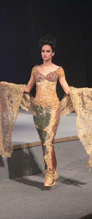 modern and glamorous kebaya with Indonesia authentic fabrics, design by raden sirait, Indonesia