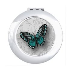 Whimsical Teal Butterfly on Gray Floral Makeup Mirror (€17) ❤ liked on Polyvore featuring beauty products and beauty accessories