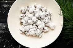 Bourban balls! 1 1/2 cups crushed ginger snap or vanilla wafer cookies (tip: use Mi-Del ginger snaps to make it gluten free) 1 cup pecans (or walnuts) 1/2 cup confectioner's sugar, plus more for dusting 1/4 cup bourbon (or rum) 2 tablespoons cocoa powder 2 tablespoons honey
