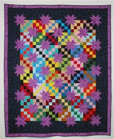 Combine the traditional Irish chain and star quilt pattern to create this gorgeous twin size quilt design. This printable quilt pattern uses a classic road to Oklahoma design, and is great for intermediate quilters. Star Quilts, Scrappy Quilts, Mini Quilts, Quilt Blocks, Star Blocks, Rag Quilt, Quilting Projects, Quilting Designs, Patchwork Designs