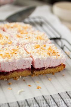 Raspberry Coconut Marshmallow Slice recipe is a crunchy cookie base, then layers of jam and homemade marshmallow, topped with coconut.