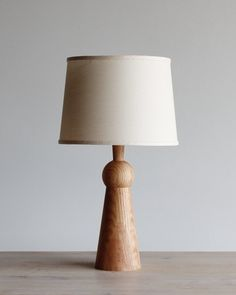 The Bella Skirt Lamp is an elegant design that adds warmth and character to any bedside table, credenza or desk. All Bella Skirt lamps are made from solid oak and finished in our workshop in Philadelphia. Table Lamp Wood, Wooden Lamp, Table Lamps, Oak Table, Farmhouse Kitchen Diy, Diy Kitchen, Checkerboard Floor, Lamp Cord, Wood Accents