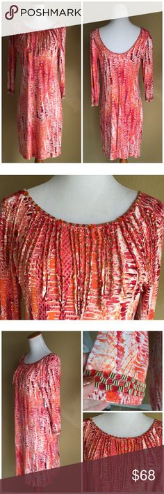 Faith hand beaded dress Beautiful vibrant dress by California designer features fringe front enhanced with beading , neckline and cuffs hand beaded too, 3/4 length sleeves , soft rayon-spandex Faith Dresses