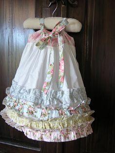 So sweet! Love the ruffles! Use pillowcase dress or O+S popover sundress pattern. Great use of scraps.