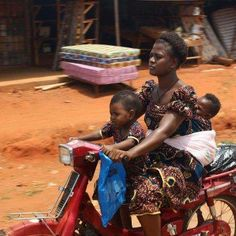 Naija woman, babywearing on the go