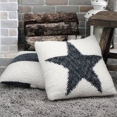 Knit a Rustic Star Pillow by using colorwork. The texture of the pillow is seed stitch. The pillow is button-fastened.