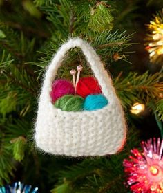 Yarn Basket Ornament: Free knitting pattern from Red Heart Yarn. Incredibly fast project that's perfect as a gift topper or as the gift itself! Just in time for the Holidays. Knitted Christmas Decorations, Knit Christmas Ornaments, Crochet Ornaments, Christmas Crafts, Xmas, Christmas Presents, Holiday Decorations, Easy Ornaments, Crochet Christmas Trees