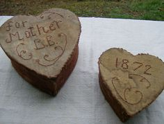 little heart boxes with needlework on top..........sweet