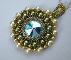 Unique one of a kind beadwoven pendant rich with Swarovski rivoli s with extra sparkly Aurora Borealis effect and Swarovski pearls. The beautiful sparkling colors make the pendant an impressive piece of art, elegant and outstanding. The pendant is hanged on a gold filled chain. As all my jewelry, this necklace is unique and outstanding; assuring you will be the center of attention anywhere you go. Made with Swarovski Elements. This unique jewelry will catch every ones eyes. The pendant is…