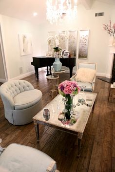 The distressed wood floors in Kyle Richards' Beverly Hills abode are made glamorous with these touches of 1950s glam from the sleek piano to the mirrored tables.
